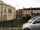 Ballyclare: There is potential for an attractive twon square, by removing the railings and at least some of the parking