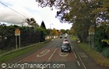 The same location in 2008 with 40 mph speed limit. (The thatched house is the first one on the left, now with a protective wall) © Google 2011